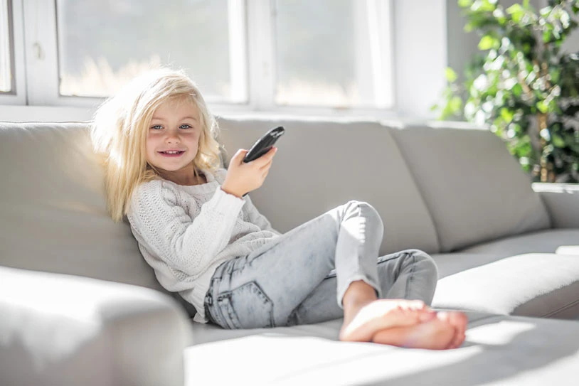 smiling-girl-with-remote-controller.JPG
